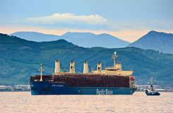 Port Alberni ship loaded with logs at anchor in the roads. Nakhodka Bay. East (Japan) Sea. 30.06.2015 Stock Photos