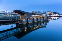 Port of Alesund town reflected in the water. Norway Royalty Free Stock Photos