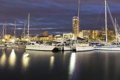 Port of Alicante during a cold winter sunset. Royalty Free Stock Photos