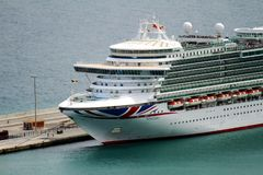 Aerial view of cruises docked in the port of Alicante. Port of Alicante with cruiseships docked in a landscape viewed from the towers of Santa Barbara Castle in Stock Images