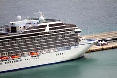 Aerial view of cruises docked in the port of Alicante. Port of Alicante with cruiseships docked in a landscape viewed from the towers of Santa Barbara Castle in Stock Image
