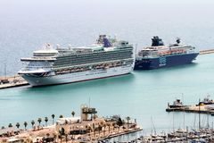 Aerial view of cruises docked in the port of Alicante. Port of Alicante with cruiseships docked in a landscape viewed from the towers of Santa Barbara Castle in Stock Photos
