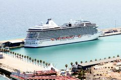 Aerial view of cruises docked in the port of Alicante. Port of Alicante with cruiseships docked in a landscape viewed from the towers of Santa Barbara Castle in Royalty Free Stock Photos
