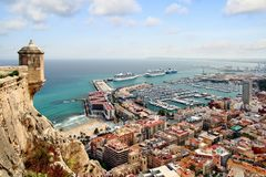 Aerial view of cruises docked in the port of Alicante. Port of Alicante with cruiseships docked in a landscape viewed from the towers of Santa Barbara Castle in Stock Photo