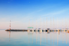Port with anchored boats on lake Balaton. Marina port with anchored boats on lake Balaton in Hungary Royalty Free Stock Photos