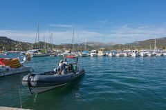 Port Andratx Mallorca. PORT ANDRATX, MALLORCA, SPAIN - AUGUST 5, 2016: Two men onboard a rib boat in port on a sunny summer day in August 5 in Port Andratx Royalty Free Stock Photography