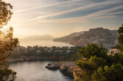 Port Andratx and villas of Cap de sa Mola at sunset, Mallorca, Baleares, Spain. Aerial view of Village of Port Andratx and villas of Cap de sa Mola at sunset Royalty Free Stock Image