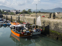 The port of Annalong in Ireland. Annalong harbour with fishing boats Royalty Free Stock Photo