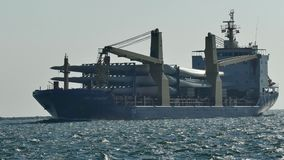 PORT ARANSAS, TX - 12 FEB 2015: Cargo ship carrying windmill propellers enters Aransas Pass. PORT ARANSAS, TX - 12 FEB 2015: Cargo ship carrying windmill stock footage