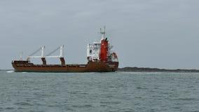 Port Aransas, TX - 5 Feb 2015: Cargo Ship FAGELGRACHT is heading out toward Port Aransas. Port Aransas, TX - 5 Feb 2015: Cargo Ship FAGELGRACHT is heading out stock footage
