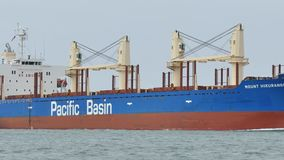 PORT ARANSAS, TX - 5 FEB 2015: Cargo Ship Mount Hikurangi is heading to sea. PORT ARANSAS, TX - 5 FEB 2015: Cargo Ship Mount Hikurangi is heading out to the stock video