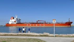 PORT ARANSAS, TX - 7 FEB 2015: People watching a cargo ship heading toward the Gulf of Mexico. PORT ARANSAS, TX - 7 FEB 2015: People watching a cargo ship stock video