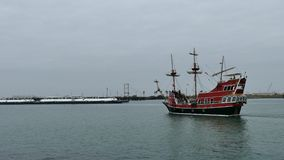 Port Aransas, TX - 6 Feb 2015: Tourist excursion boat and commercial barge approach each other. Port Aransas, TX - 6 Feb 2015: Tourist excursion boat and stock video