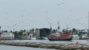 Port Aransas, TX - 6 Feb 2015: Tourist excursion boat leaves the marina on an overcast day. Port Aransas, TX - 6 Feb 2015: Tourist excursion boat leaves the stock footage