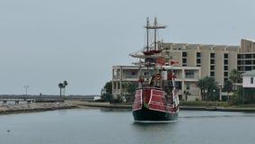 Port Aransas, TX - 6 Feb 2015: Tourist excursion boat leaves the marina on an overcast day. Port Aransas, TX - 6 Feb 2015: Tourist excursion boat leaves the stock video footage