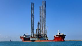 PORT ARANSAS, TX - 06 MAR 2016: Semi submersible heavy lift cargo ship. Transporting an offshore oil rig out to sea stock photography