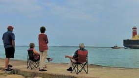 Port Aransas, TX - March 1, 2017: Seniors watch as pilot boat turns from ship.