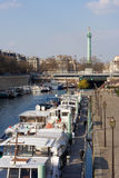 The port of Arsenal. With the Bastille square in the background - Paris, France stock images