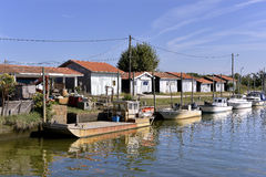 Port of  Audenge in France. Boats and barge in the ostreicole harbor of Audenge, commune is a located on the northeast shore of Arcachon Bay, in the Gironde Stock Photo