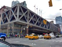 Port Authority Bus Terminal, PABT, Traffic on 8th Avenue, NYC, NY, USA. Port Authority Bus Terminal, PABT, looms large above the traffic on 8th Avenue. This Stock Images