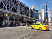 Port Authority Bus Terminal, Taxi, NYC, NY, USA. A taxi turns north onto 8th Avenue from West 41st Street, directly in front of Port Authority Bus Terminal. This Royalty Free Stock Photos