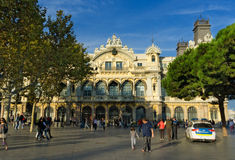 Port authority at Port Vell Barcelona. People are walking by square in front of  the Port authority at Port Vell Barcelona Spain Royalty Free Stock Image