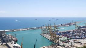 Port of Barcelona from viewing point. Port of Barcelona, cranes, containers from viewing point on Montjuic hill stock video