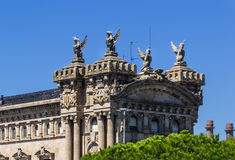Port of Barcelona. Historic sculptures on the building of the Port of Barcelona, Spain royalty free stock photos