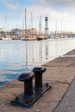 Port of Barcelona, Spain. Big black steel bollard Royalty Free Stock Images