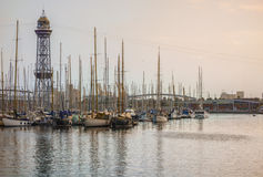 Port of Barcelona, Spain. Evening and golden hour view of yachts, sailing boats and old big tower Stock Photo