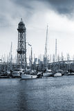 Port of Barcelona, Spain. Yachts, boats and old big tower Stock Photo