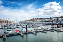 Port in the bay of Albufeira, Portugal, many boats and yachts in. The background of the city, a popular destination for travel and recreation in Europe stock photo