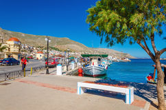 Port with bench and moored boat on Kalymos, Greece Stock Photography