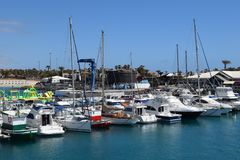 Port in Caleta de Fuste, Fuerteventura, Canary Island. Port and boats parked on coast in Caleta de Fuste on island Fuerteventura. Canary island royalty free stock images