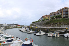 Port with boats and some buildings in Llanes Stock Images