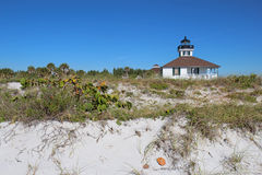 Port Boca Grande Lighthouse, Gasparilla Island. The Port Boca Grande Lighthouse on Gasparilla Island, Florida viewed from the sand dunes with sea oats (Uniola Stock Photo