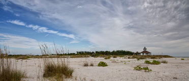 The Port Boca Grande Lighthouse Panorama. Port Boca Grande Lighthouse on Gasparilla Island, Florida viewed from the beach Stock Photos