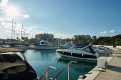 Port of Cabopino in Marbella. With a few yachts and boats Stock Images