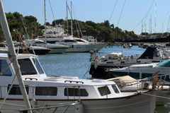 Port Cala Llonga, Cruise Ship from Es Forti, Cala d´Or, Cala Gran, Cala Esmeralda, Cala Ferrera to Porto Colom, Majorca. Port Cala Llonga, Cruise Ship from Es Royalty Free Stock Photography