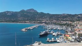 Port of Calvi. Beautiful view of the port of Calvi with a beautiful sea and the Corsican mountain in the background Stock Photography