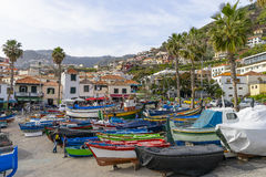 Port in Camara de Lobos. Boats on the shore of the ocean in the port near the Funchal in small fishing village Camara de Lobos on south coast of Madeira island Royalty Free Stock Image