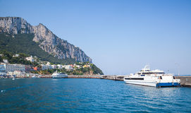 Port of Capri, Italy. Passenger ferries are moored Royalty Free Stock Photography