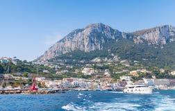 Port of Capri, Italy. Pleasure boats go near breakwater Royalty Free Stock Images