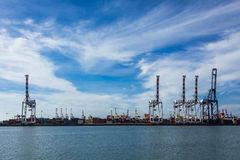 Port cargo crane and container. Over blue sky background Royalty Free Stock Photo