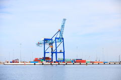 Port cargo crane and container over blue sky Stock Photography