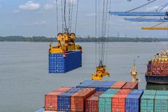 Port cargo crane and containers royalty free stock photo