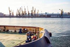 Port cargo crane over blue sky background. Sea port, crane for loading at sunset. Transportation Stock Photography