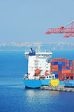 Port cargo crane, ship and container Stock Photography