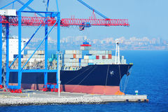 Port cargo crane, ship and container Stock Images