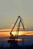 Port cargo crane at sunset Royalty Free Stock Image